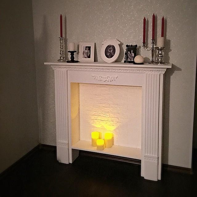 Имитация камина на интерьере квартиры